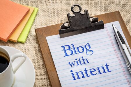 intent: blog with intent advice or reminder on a clipboard with a cup of coffee