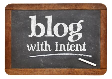 content writing: blog with intent  - blogging advice on a vintage slate blackboard