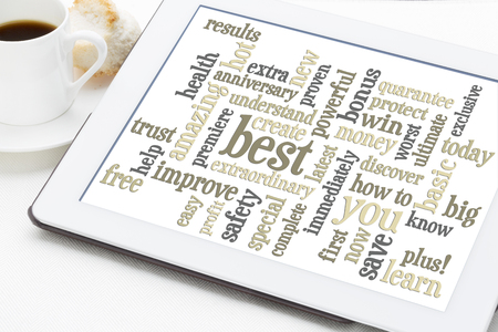 copywriting: copywriting power words - word cloud on a digital tablet with a cup of coffee Stock Photo