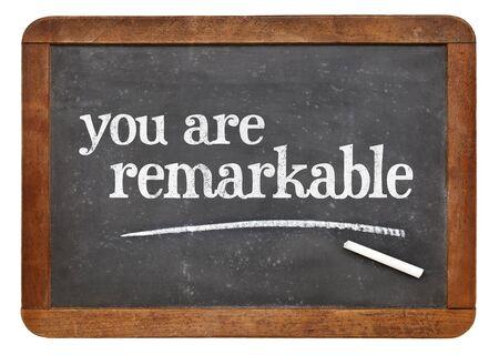 remarkable: You are remarkable  - positive affirmation words on a vintage slate blackboard