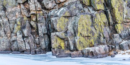 fort collins: panorama view of frozen river and canyon wall covered by lichen - Cache la Poudre River at Gateway near Fort Collins, Colorado