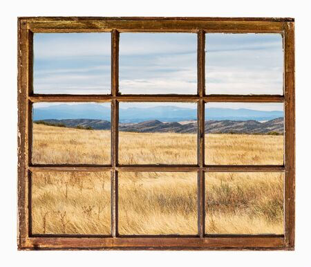 sash: prairie with dry grass at Colorado foothills  as seen  through vintage, grunge, sash window with dirty glass Stock Photo