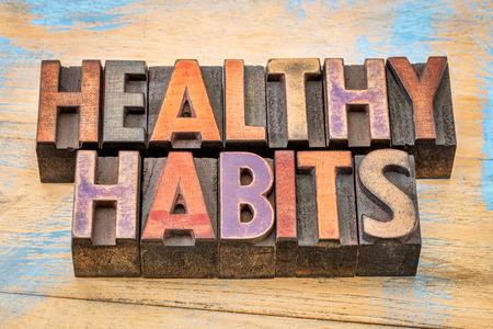 healthy habits words in vintage letterpress wood type printing blocks against painted wood