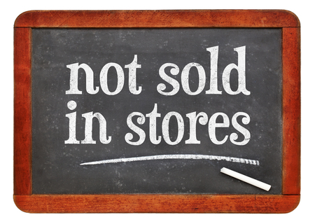 not sold in stores - marketing concept - white chalk text on a vintage slate blackboard