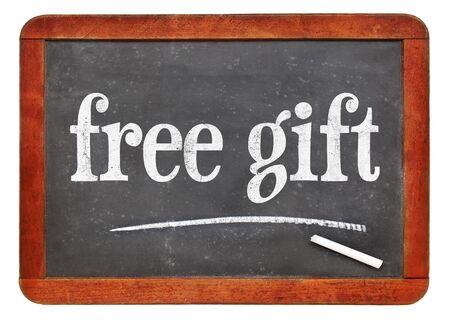 free gift: free gift - marketing concept - white chalk text on a vintage slate blackboard Stock Photo