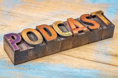 podcast: podcast sign - vintage letterpress wood type over grunge, painted wood