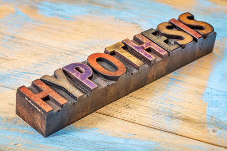 hypothesis word - text in vintage wooden letterpress printing blocks against grunge painted wood