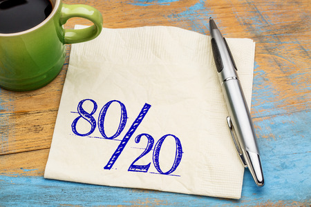 Pareto principle or eighty-twenty rule represented on a napkin with a cup of coffee  - a reminder or advice Stock Photo