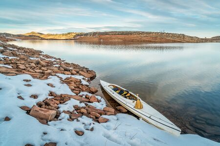horsetooth reservoir: decked expedition canoe on a shore  of Horsetooth Reservoir near Fort Collins in northern Colorado, winter scenery with some snow Stock Photo