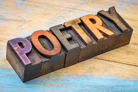 letterpress: poetry word - text in vintage  letterpress wood type printing blocks Stock Photo