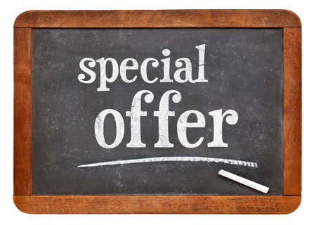 special offer - white chalk text on a vintage slate blackboard, marketing concept