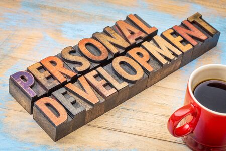 personal development - text in vintage letterpress wood type with a cup of coffee