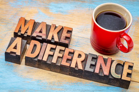 difference: make a difference - motivational words in vintage letterpress wood type with a cup of coffee