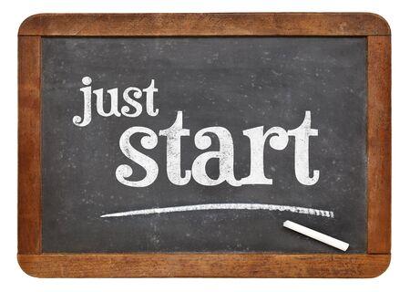 just start sign - white chalk text on a vintage slate blackboard Stock Photo
