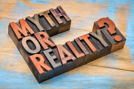 Myth or reality?A question in vintage letterpress wood type against grunge painted wood