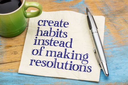 create habits instead of resolutions - motivational advice or reminder on a napkin with a cup of coffee