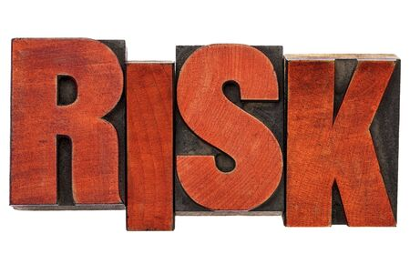 printing block block: risk - isolated word abstract  in vintage letterpress wood type stained by red ink