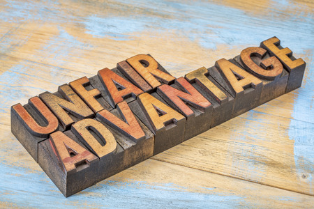 unfair advantage - word abstract n vintage letterpress wood type blocks stained by color inks