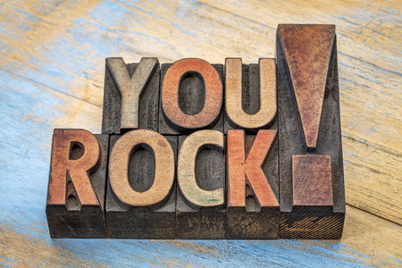 You rock compliment in vintage letterpress wood type printing blocks stained by color inks Stock Photo - 52656225
