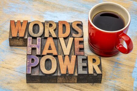words have power  phrase in vintage letterpress wood type printing blocks stained by color inks with a cup of coffee 스톡 콘텐츠