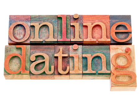 letterpress words: online dating banner - isolated words in vintage wood letterpress printing blocks stained by color ink Stock Photo