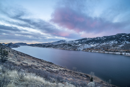 collins: winter dawn over mountain lake - Horestooth Reservoir near Fort Collins in northern Colorado, winter scenery before sunrise