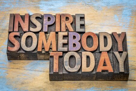 wood type: inspire somebody today - motivational text in vintage letterpress wood type