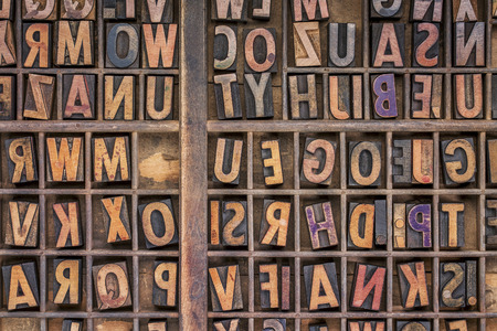 typesetter: vintage letterpress wood type printing blocks  in a grunge typesetter drawer Stock Photo