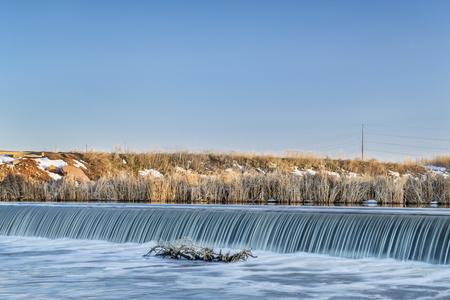 diversion: river diversion dam on St Vrain Creek in northern Colorado near Platteville, winter scenery Stock Photo
