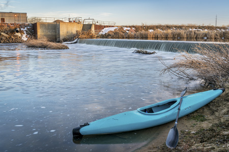diversion: blue whitewater kayak and river diversion dam - St Vrain Creek near Platteville in northern Colorado
