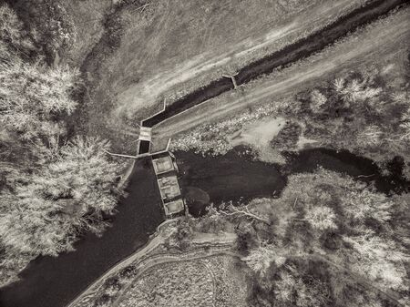collins: aerial view of the diversion dam providing water for farming - Cache la Poudre River at Fort Collins, Colorado