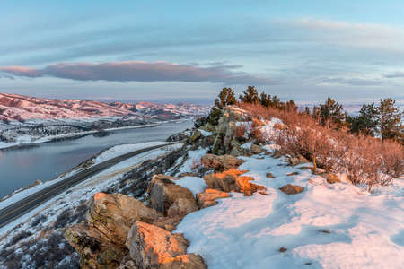 horsetooth rock: winter sunrise over Horsetooth Reservoir and Centennial Road near Fort Collins in northern Colorado Stock Photo