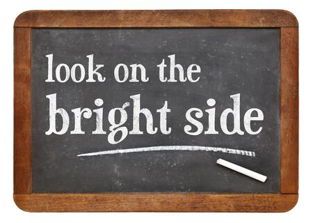look on the bright side - positivity concept - white chalk text on a vintage slate blackboard