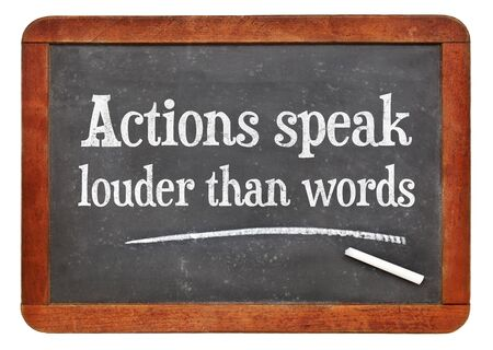 proverb: Actions speak louder than words proverb - white chalk text on a vintage slate blackboard