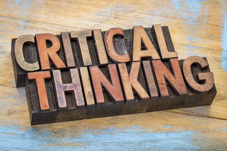 critical thinking: critical thinking word abstract - text in vintage letterpress wood type printing blocks stained by color inks