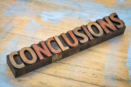 conclusions word in vintage letterpress wood type printing blocks stained by color inks