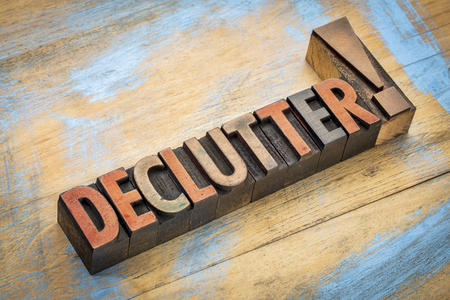 declutter exclamation - word in vintage letterpress wood type printing blocks stained by color inks