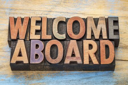 aboard: welcome aboard sign in vintage letterpress wood type blocks stained by color inks