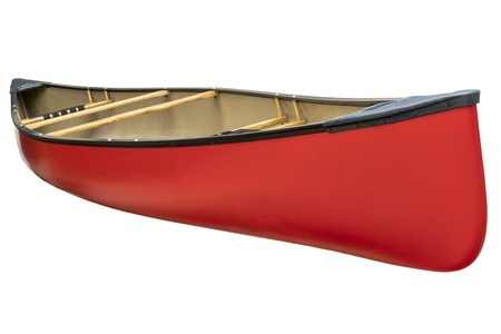canoeing: red tandem canoe with wood seats isolated on white with a clipping path