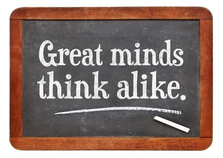 proverb: Great minds think alike proverb white chalk text on a vintage slate blackboard