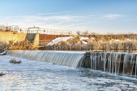 river diversion dam on St Vrain Creek in northern Colorado near Platteville, winter scenery Banco de Imagens