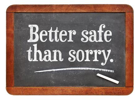 better safe than sorry: Better safe than sorry proverb - white chalk text on a vintage slate blackboard