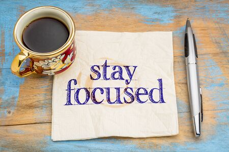 stay focused reminder or advice - handwriting  on napkin with cup of coffee against a grunge painted wood Imagens - 53073762