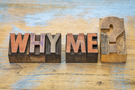 Why me question  - text in vintage letterpress wood type blocks stained by color inks Zdjęcie Seryjne
