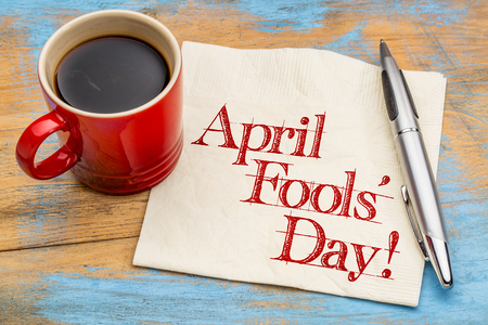 April Fools Day! Handwriting on a napkin with a cup of coffee Stock Photo