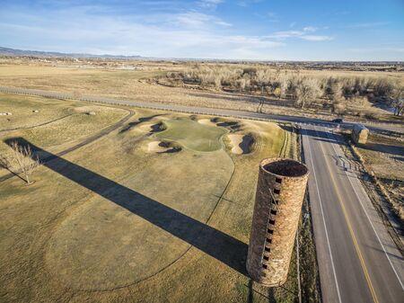 cache la poudre river: farm silo and golf course along Cache la Poudre River in Colorado, aerial view in early springtime