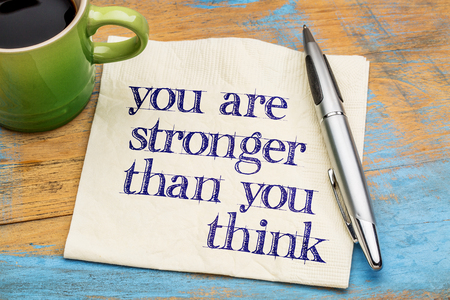 strong message: You are stronger than you think - inspirational message -handwriting on napkin with a cup of coffee Stock Photo