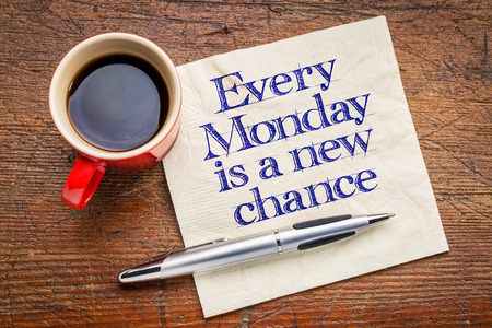 advice: Every Monday is a new chance - motivational handwriting on napkin with a cup of coffee Stock Photo