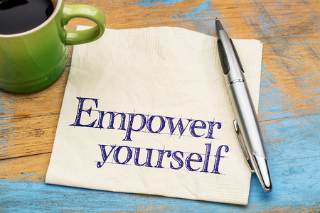 empower: empower yourself  - handwriting on a napkin with a cup of coffee