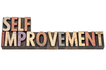 self improvement: self improvement words  - isolated text in vintage letterpress  wood type printing blocks